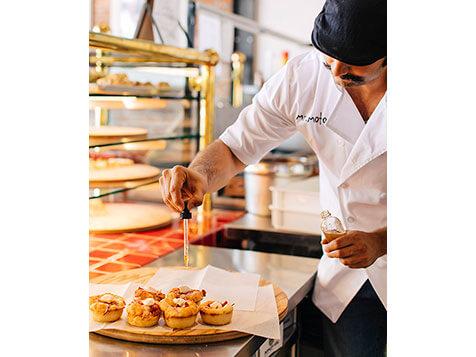Mr. Moto Pizza franchise - making the pizza